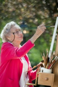 Senior-woman-painting-a-canvas